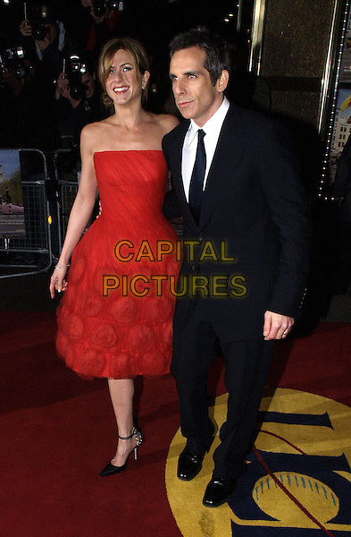 "BEN STILLER & JENNIFER ANISTON.Premiere ""Along Came Polly"".Empire cinema, Leicester Square.full length, full-length, strapless red dress.London 18 February 2004.www.capitalpictures.com.sales@capitalpictures.com.©Capital Pictures."