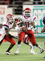 Manatee Hurricanes quarterback Brodrick Yancy #11 hands off to running back Antonio Agurs #34 during the fourth quarter of the Florida High School Athletic Association 7A Championship Game at Florida's Citrus Bowl on December 16, 2011 in Orlando, Florida.  Manatee defeated First Coast 40-0.  (Mike Janes/Four Seam Images)