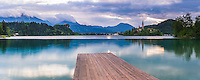 Lake Bled jetty at sunrise, showing the Church on Lake Bled Island and Bled Castle, Gorenjska Region, Slovenia, Europe