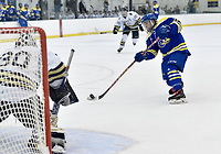 Delaware's Brian Ostrander (26) shoots a puck past Navy goalie Thatcher Givens (30) for a 2nd period goal. Delaware defeated Navy 8-3 at McMullen Hockey Arena.<br /> <br /> Photo by Randy Litzinger