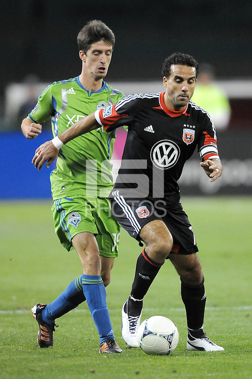 D.C. United forward Dwayne De Rosario (7) shields the ball against Seattle Sounders forward Alvaro Fernandez (15)  D.C. United tied the Seattle Sounders, 0-0 at RFK Stadium, Saturday April 7, 2012.