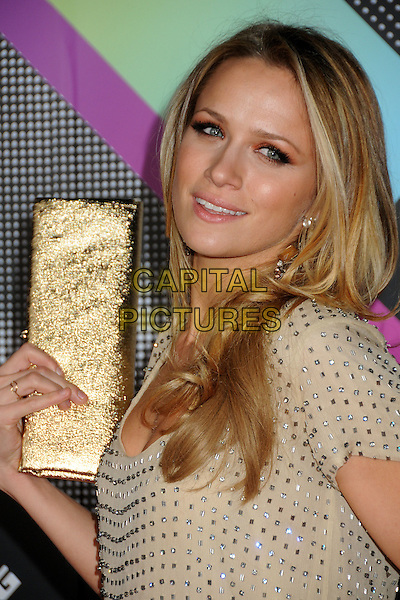 SHANTEL VANSANTEN.The T-Mobile Sidekick 4G Launch Party held at a private lot in Beverly Hills, California, USA..April 20th 2011.headshot portrait beige top  embellished jewel encrusted gold clutch bag.CAP/ADM/BP.©Byron Purvis/AdMedia/Capital Pictures.