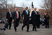 In Washington, DC on February 25, 2010, United States President Barack Obama, along with U.S. Senate Majority Whip Richard Durbin (Democrat of Illinois) and U.S. Vice President Joseph Biden, returns to the White House after hosting a bipartisan meeting with members of Congress to discuss health reform legislation in the nearby Blair House..Credit: Jim Lo Scalzo / Pool via CNP