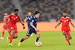 Doan Ritsu of Japan (C) is followed by Ahmed Al Mahaijri (L) and Harib Al Saadi of Oman (R) during the AFC Asian Cup UAE 2019 Group F match between Oman (OMA) and Japan (JPN) at Zayed Sports City Stadium on 13 January 2019 in Abu Dhabi, United Arab Emirates. Photo by Marcio Rodrigo Machado / Power Sport Images