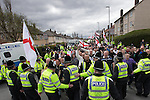 © Joel Goodman - 07973 332324 . 04/05/2013 . Leeds , UK . The English Defence League hold a demonstration in the Moortown housing estate in Leeds over plans to convert a disused pub in to an Islamic Centre . This is the first EDL demonstration in the region since six men were convicted of planning a terrorist attack on an EDL demonstration in Dewsbury . Photo credit : Joel Goodman