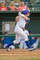 Mark Reed #8 of the Daytona Cubs follows through on his swing against the against the Dunedin Blue Jays at Jackie Robinson Stadium June 18, 2010, in Daytona Beach, Florida.  Photo by Brian Westerholt /  Seam Images