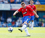 John Fleck fires in a shot but it fizzes narrowly wide