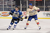 Lake Erie Monsters winger Bryan Lerg (20) and Rochester Amerks defensemen Matt MacKenzie (47) during overtime of The Frozen Frontier outdoor AHL game at Frontier Field on December 13, 2013 in Rochester, New York.  (Copyright Mike Janes Photography)
