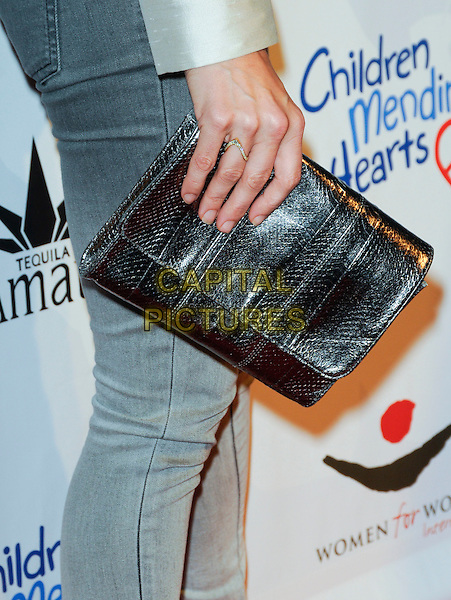 "KATE WALSH's clutch bag .Arriving at Children Mending Hearts' 3rd Annual ""Peace Please"" Gala at the Music Box @ Fonda in Hollywood, California, USA, April 16th 2010..hand detail silver  .CAP/ROT.©Lee Roth/Capital Pictures"