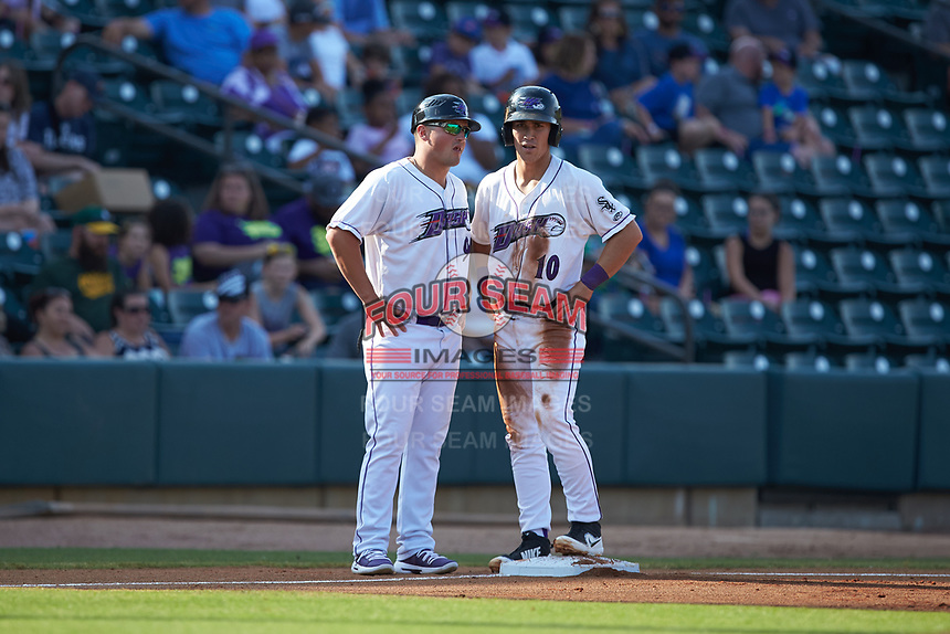 Winston-Salem Dash manager Justin Jirschele (9) talks to JJ Muno (10) as he stands on third base during the game against the Carolina Mudcats at BB&T Ballpark on June 1, 2019 in Winston-Salem, North Carolina. The Mudcats defeated the Dash 6-3 in game one of a double header. (Brian Westerholt/Four Seam Images)