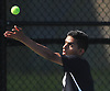 Abhinav Srivastava of Half Hollow Hills East serves to Jackson Weisbrot of Hills West (not in picture) in the first singles match of the Suffolk County varsity boys tennis team championship at Half Hollow Hills High School East on Wednesday, May 17, 2017.