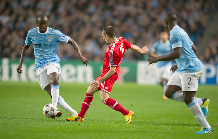 Manchester City's Yaya Toure shields the ball from Bayern Munich's Franck Ribery<br /> <br /> Photo by Stephen White/CameraSport<br /> <br /> Football - UEFA Champions League Group D - Manchester City v Bayern Munich - Wednesday 2nd October 2013 -  Etihad Stadium - Manchester<br /> <br /> &copy; CameraSport - 43 Linden Ave. Countesthorpe. Leicester. England. LE8 5PG - Tel: +44 (0) 116 277 4147 - admin@camerasport.com - www.camerasport.com
