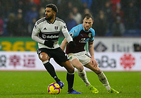 Fulham's Cyrus Christie shields the ball from Burnley's Ashley Barnes<br /> <br /> Photographer Alex Dodd/CameraSport<br /> <br /> The Premier League - Burnley v Fulham - Saturday 12th January 2019 - Turf Moor - Burnley<br /> <br /> World Copyright © 2019 CameraSport. All rights reserved. 43 Linden Ave. Countesthorpe. Leicester. England. LE8 5PG - Tel: +44 (0) 116 277 4147 - admin@camerasport.com - www.camerasport.com