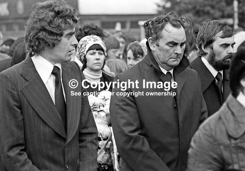 Jimmy Drumm, centre with collar turned up, at the funeral of his wife, Maire Drumm, Belfast, N Ireland, until recently vice president of Provisional Sinn Fein, who was murdered by loyalist gunmen In the city's Mater Hospital whilst she was waiting for an operation. 1st November 1976. 197611010494e<br />