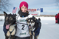 Bailey Schaeffer with her lead dogs at the finish line of the 2016 Junior Iditarod in Willow, Alaska, AK  February 28, 2016