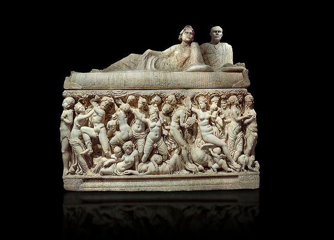 """Roman relief sculpted sarcophagus depicting a scene with Dionysus made in a Greek Attica workshop, 3rd century AD, Perge Inv 1.35.99. Antalya Archaeology Museum, Turkey.<br /> <br /> The lid of the sarcophagus is sculpted into the form of a """"Kline"""" style Roman couch on which lie Julianus &  Philiska. This type of Sarcophagus is also known as a Sydemara Type of Tomb. Against a black background."""