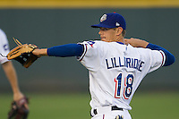 Round Rock Express second baseman Brent Lillibridge #18 warms up before the Pacific Coast League baseball game against the Oklahoma City Redhawks on April 3, 2014 at the Dell Diamond in Round Rock, Texas. The Redhawks defeated the Express 7-6 in the season opener for both teams. (Andrew Woolley/Four Seam Images)