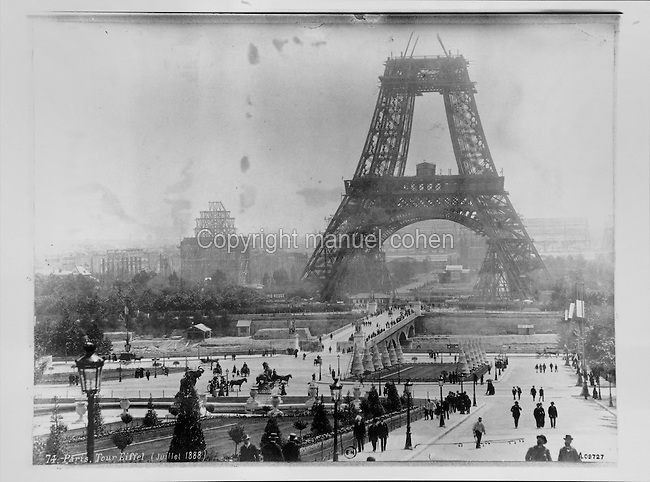 Construction of the Eiffel Tower and the exhibition buildings for the World Fair of 1889, held in Paris on the Champ de Mars, on the 100th anniversary of the Storming of the Bastille, photograph, July 1888. Copyright © Collection Particuliere Tropmi / Manuel Cohen