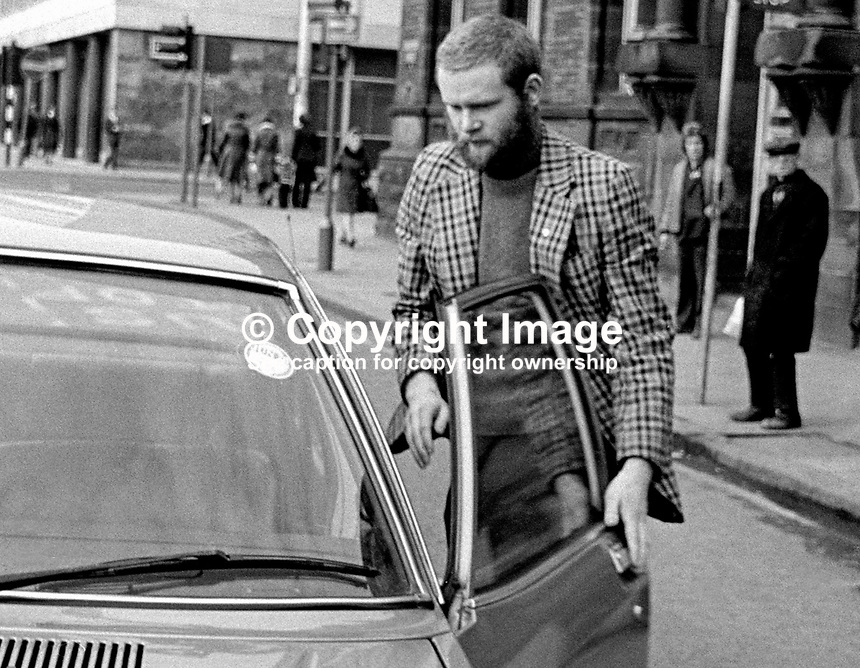 Derry republican Martin McGuinness is whisked away in a waiting car on leaving a Belfast Court, 2nd March 1976, a free man after a charge alleging IRA membership was dropped due to lack of evidence. 197603020125d.<br />
