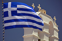 Michael McCollum.6/17/11.The national flag in the wind in Mykonos , Greece.