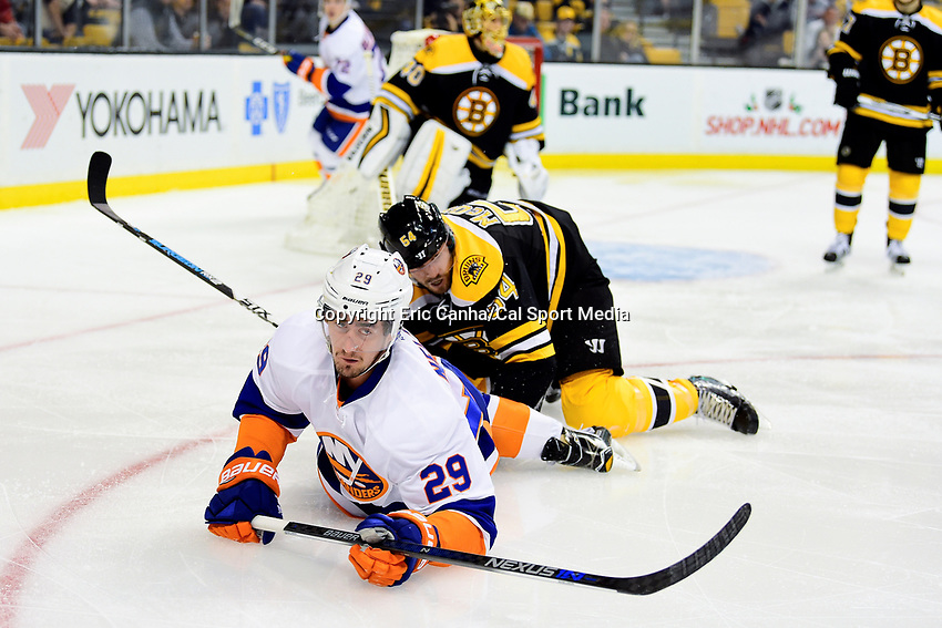 Tuesday, December 20, 2016: New York Islanders left wing Brock Nelson (29) and Boston Bruins defenseman Adam McQuaid (54) battles on the ice during the National Hockey League game between the New York Islanders and the Boston Bruins held at TD Garden, in Boston, Mass. The Islanders defeat the Bruins 4-2. Eric Canha/CSM