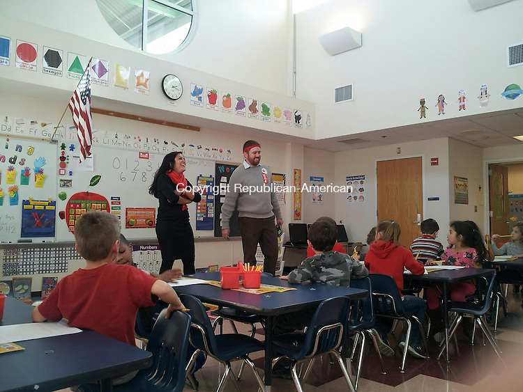 TORRINGTON, CT- 29 October 2013- 102913BJ02-- Pete Kapitancek, a program facilitator with the McCall Foundations, and Mrs. Lana Cifaldi talks to children in Mrs. Cifaldi's afternoon kindergarten class at Southwest School. Bruno Matarazzo Jr. Republican-America