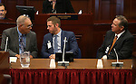 Lobbyists, from left, Ray Bacon, Paul Enos and Danny Thompson wait for their turn to testify on the Assembly floor during the second day of a special session at the Nevada Legislature, in Carson City, Nev., on Thursday, Sept. 11, 2014. Lawmakers are considering a complex deal to bring Tesla Motors to Nevada. (AP Photo/Cathleen Allison)