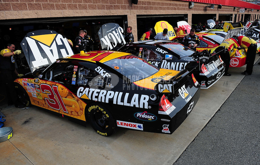 Feb 21, 2009; Fontana, CA, USA; The cars of NASCAR Sprint Cup Series drivers Jeff Burton (31), Casey Mears (07), and Kevin Harvick (29) in the garage during practice for the Auto Club 500 at Auto Club Speedway. Mandatory Credit: Mark J. Rebilas-