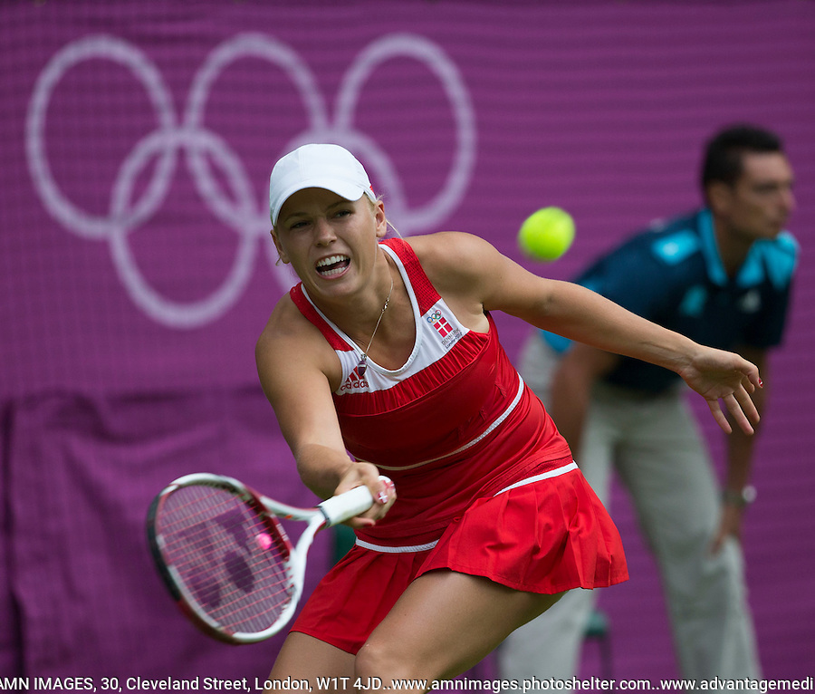 Caroline Wozniacki - Denmark..Tennis - OLympic Games -Olympic Tennis -  London 2012 -  Wimbledon - AELTC - The All England Club - London - Saturday 28th June  2012. .© AMN Images, 30, Cleveland Street, London, W1T 4JD.Tel - +44 20 7907 6387.mfrey@advantagemedianet.com.www.amnimages.photoshelter.com.www.advantagemedianet.com.www.tennishead.net
