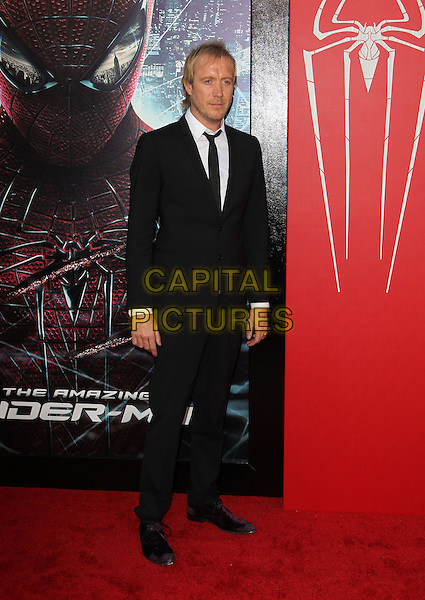 "Rhys Ifans.Los Angeles Premiere Of ""The Amazing Spider-Man"" Held The at Regency Village Theatre, Westwood, California, USA..June 28th, 2012.full length black suit .CAP/ADM/FS.©Faye Sadou/AdMedia/Capital Pictures."