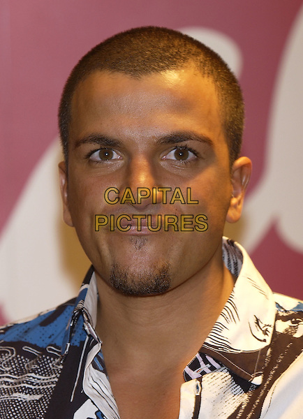 "PETER ANDRE.At ""Brand Licensing2004"" .Earls Court Exhibition Centre,.London, 25 October 2004..portrait headshot.Ref: PL.www.capitalpictures.com.sales@capitalpictures.com.©Capital Pictures."