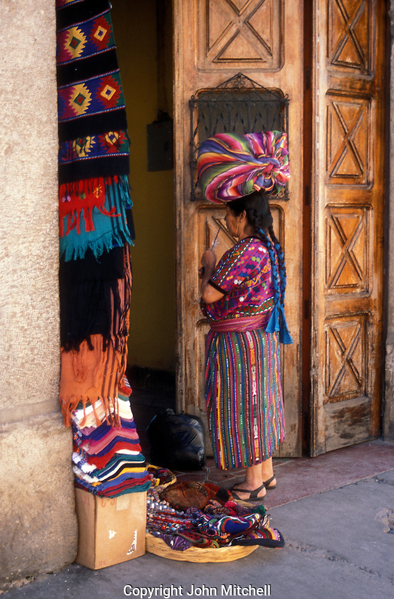 Mayan woman selling weavings in the Spanish colonial town of Antigua, Guatemala