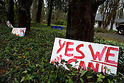 March 31, 2008. Chapel Hill, NC..Due to the large grassroots movement supporting presidential candidate Barack Obama, supporters and entrepreneurs have taken to making their own merchandise and signs. . Handmade signs in the front yard of  house in Chapel Hill.