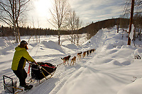 Wednesday March 7, 2012  Trent Herbst on the road toward Ophir after leaving the Takotna checkpoint.   Iditarod 2012.