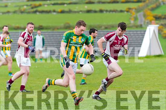 Lios Póil Alan Devane in possession of the ball closely watched by Cromane Emmett Casey during the Junior (Novice) Championship match at the Lispole GAA Grounds on Sunday afternoon.