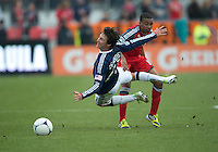 14 April 2012: Chivas USA midfielder Ben Zemanski #21 and Toronto FC midfielder Reggie Lambe #19 in action during the second half in a game between Chivas USA and Toronto FC at BMO Field in Toronto..Chivas USA won 1-0.