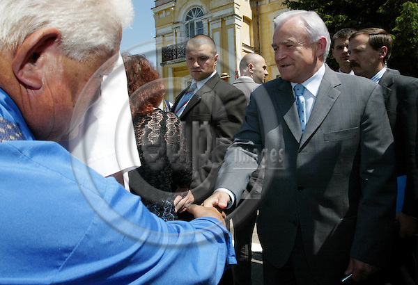SITNO - POLAND - 05 JUNE 2003 --Polish EU-Referendum.-- Polish Prime Minister Leszek MILLER (R) at the Yes campaign rally in the small village of SITNO. Even though Leszek MILLERs popularity has decreased his autograph and hand shake was popular. -- PHOTO: JUHA ROININEN / EUP-IMAGES