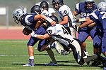 Torrance, CA 09/05/13 - Evan Conrow (Peninsula #42) and unidentified North JV player(s) in action during the Peninsula vs North Junior Varsity football game played at North High School in Torrance, California.
