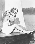 Woman and dog on sailboat