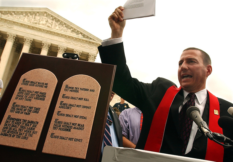 Reverend Rob Schenk, president of the National Clergy Council, speaks in front of the Supreme Court with a replication of the Ten Commandments.  He was there for the Supreme Court ruling on display of the scriptures, in the states of Kentucky and Texas.