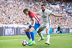 Filipe Luis (l) of Atletico de Madrid battles for the ball with Daniel Carvajal Ramos of Real Madrid during their La Liga match between Real Madrid and Atletico de Madrid at the Santiago Bernabeu Stadium on 08 April 2017 in Madrid, Spain. Photo by Diego Gonzalez Souto / Power Sport Images