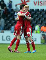 Saturday, 15 March 2014<br /> Pictured: Liam Ridgewell (L) and Liam O'Neil (R) of West Brom celebrating their win after the final whistle.<br /> Re: Barclay's Premier League, Swansea City FC v West Bromwich Albion at the Liberty Stadium, south Wales, UK.