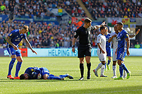 Referee Robert Jones (C) calls physiotherapists to see to Sean Morrison of Cardiff City who is injured on the ground during the Sky Bet Championship match between Swansea City and Cardiff City at the Liberty Stadium, Swansea, Wales, UK. Sunday 27 October 2019