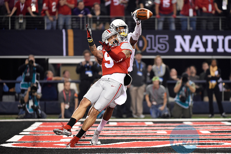 12 JAN 2015:  Devin Smith (9) of the Ohio State University draws a pass interference call on Troy Hill (13) of the University of Oregon during the College Football Playoff National Championship held at AT&T Stadium in Arlington, TX.  Ohio State defeated Oregon 42-20 for the national title.  Jamie Schwaberow/NCAA Photos