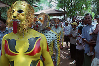 Pulikali performers fully decked up for performance, Trichur, Kerala, India..Pulikali or Kaduvvakali is a two hundred year old folk dance form, practised mostly in Thrissur and Palghat districts of Kerala. It liberally makes use of forms and symbols of nature that finds expression in its bright, bold body painting and high-energy dance movements. The philosophy of Pulikali is that human and nature are integral parts of each other. So by fusing man and beast in its artistic language, it flamboyantly celebrates the connection. Arindam Mukherjee