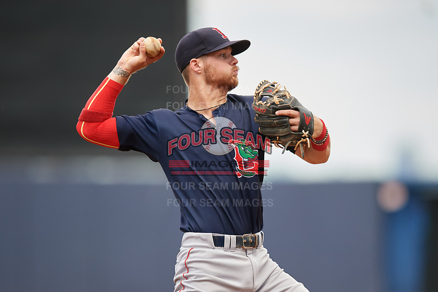 Lowell Spinners shortstop Korby Batesole (12) throws to first base during a game against the Staten Island Yankees on August 22, 2018 at Richmond County Bank Ballpark in Staten Island, New York.  Staten Island defeated Lowell 10-4.  (Mike Janes/Four Seam Images)
