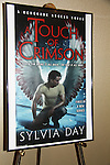 """Author Sylvia Day """"A Touch of Crimson"""" poster at Romantic Times Booklovers Annual Convention 2011 - The Book Industry Event of the Year - April 6th to April 10th at the Westin Bonaventure, Los Angeles, California for readers, authors, booksellers, publishers, editors, agents and tomorrow's novelists - the aspiring writers. (Photo by Sue Coflin/Max Photos)"""