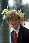 Eton schoolboy in floral hat Founders day Parents day June 4th celebrations.  The English Season published by Pavilon Books 1987