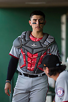 Salt River Rafters catcher Tres Barrera (12), of the Washington Nationals organization, talks to relief pitcher Jordan Mills (28) in the dugout during the Arizona Fall League Championship Game against the Peoria Javelinas at Scottsdale Stadium on November 17, 2018 in Scottsdale, Arizona. Peoria defeated Salt River 3-2 in 10 innings. (Zachary Lucy/Four Seam Images)