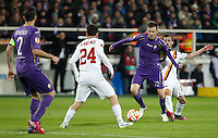 Calcio, Europa League: Andata degli ottavi di finale Fiorentina vs Roma. Firenze, stadio Artemio Franchi, 12 marzo 2015.<br /> Fiorentina's Josip Ilicic, second from right, is challenged by Roma's Miralem Pjanic, right, and Alessandro Florenzi, past Fiorentina's Gonzalo Rodriguez, left, during the Europa League round of 16 first leg football match between Fiorentina and Roma at Florence's Artemio Franchi stadium, 12 March 2015.<br /> UPDATE IMAGES PRESS/Isabella Bonotto